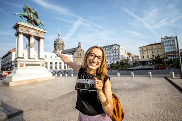 Portrait of a young woman tourist on the central square of Clermont-Ferrand square in France