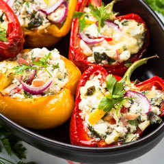 Stuffed paprika peppers with cheese and herbs. Close up.