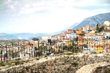 Kruja, small historical town in central Albania, buildings situated on top of a hill.