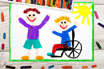 Photo of colorful drawing: Smiling boy sitting on his wheelchair. Disabled boy with a friend