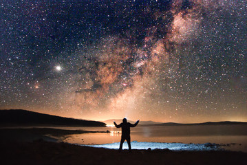 man staring in the stars