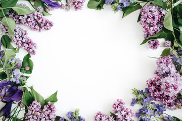 Poster Lilac Frame of lilac flowers, branches, leaves and petals with space for text on white background. Flat lay, top view
