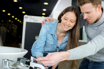 couple at plumbing store choosing sink