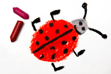 Photo of colorful drawing: Smiling ladybug on white paper background, with crayons.