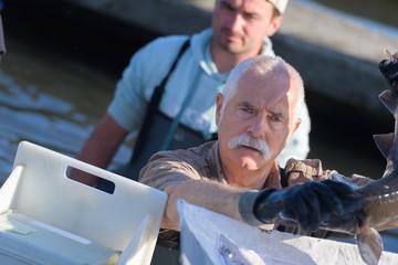 fish farmer looking at the camera