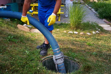 Emptying household septic tank. Cleaning sludge from septic system.