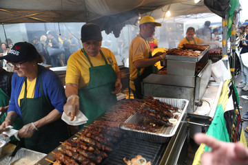Vendors serve food during the Brazilian Day 2017 festival in New York City