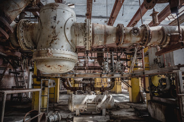 Metal Fuel and Power Generation Rusty Equipment in Abandoned Factory Interior