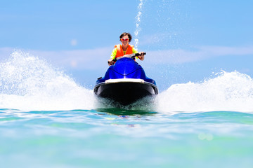 Recess Fitting Water Motor sports Teenager on water scooter. Teen age boy water skiing.