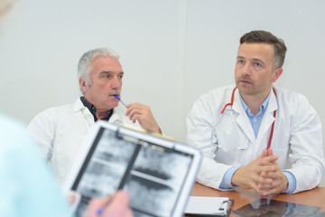 doctors thinking of the best decision to treat a patient