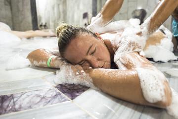 Young woman in hammam or turkish bath