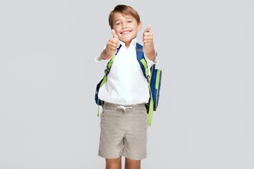 Smiling little boy with backpack.