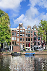 Ancient brick mansions in the Amsterdam historical canal belt.
