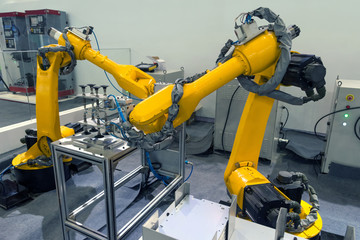 Manufacturing production industrial machine , factory robots arm in smart factory and industry 4.0 concept.