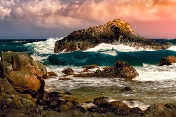 Dramatic sunset with stormy Atlantic waters in Arikok national park, Aruba. Wall mural