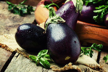 Fresh eggplants, rustic style, vintage wooden background, selective focus