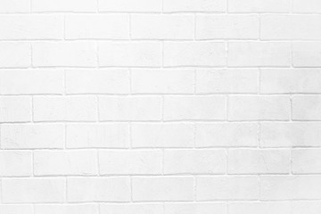 Abstract weathered textured white brick wall background.