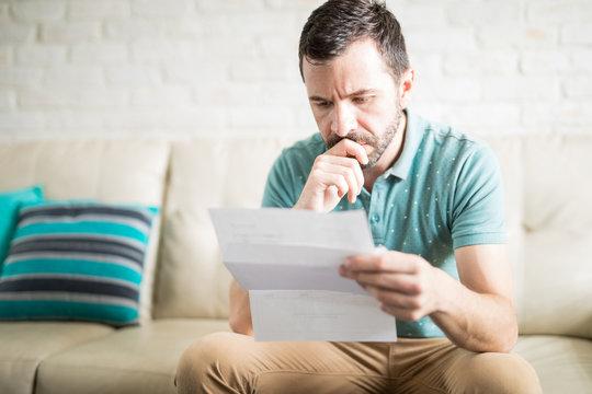 Latin man reading correspondence