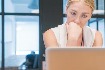 Sad woman on laptop computer