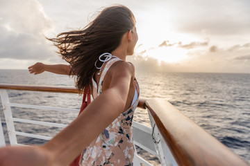 Wall Mural - Cruise ship vacation travel woman enjoying freedom. Holiday tourist with open arms in front of boat feeling carefree in the tropical wind .