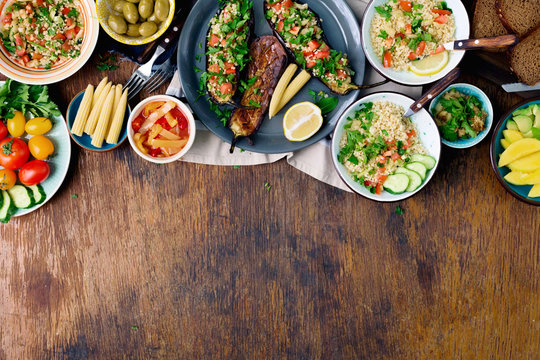 Stuffed eggplants, salad with bulgur, fruits, vegetables. healthy vegetarian food