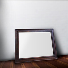 Blank wooden Photo frame on wood floor leaning the wall use for product display.