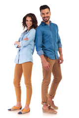 full body of a casual couple smiling