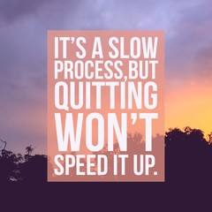"Inspirational motivational quote ""It's a slow process,but quitting won't speed it up"" on sunrise sky background."