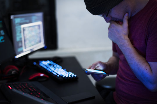 Hacker hacking a coding cyberspace information