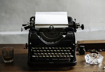 Closeup of retro vintage typewriter on wooden table
