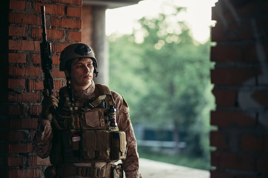 Army soldier in Protective Combat Uniform holding Special Operations Forces Combat Assault Rifle