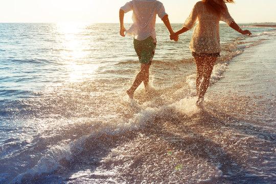 Happy young couple enjoying the sea