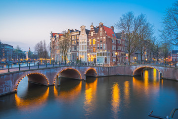 Amsterdam city at night with dutch old buildings in Netherlands