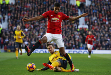 Manchester United's Marcus Rashford in action with Arsenal's Nacho Monreal