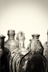 Old colourful bottles against a white background