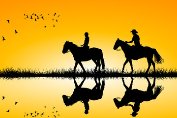 Two riders on horses standing together on sunset