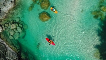 Whitewater Rafting on the Emerald waters of Soca river, Slovenia, are the rafting paradise for adrenaline seekers and also nature lovers, aerial view. Wall mural