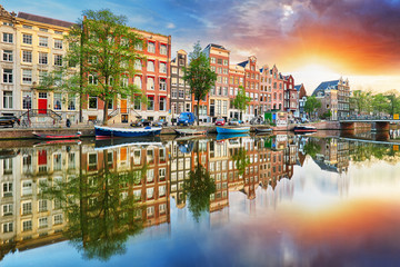Amsterdam Canal houses at sunset reflections, Netherlands, panorama