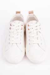 Pair of new white sneakers, isolated on white background