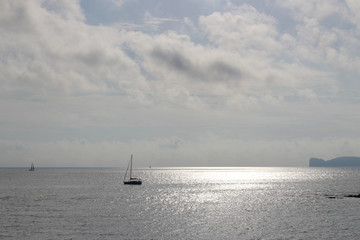 A boat sailing toward the horizon