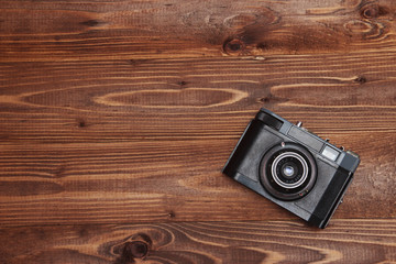 Vintage camera on wooden background