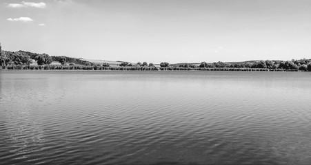Photo of nature around beautiful blue lake black and white