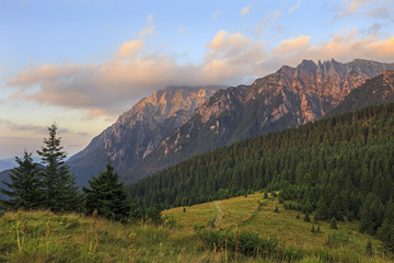 Picturesque view of the mountains under first sunlight. Dramatic morning scene. Carpathians Romania.