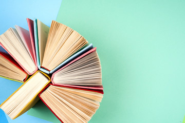 Top view of bright colorful hardback books in a circle.