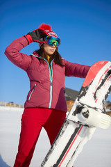 Happy young snowboard girl on the snow sunny day