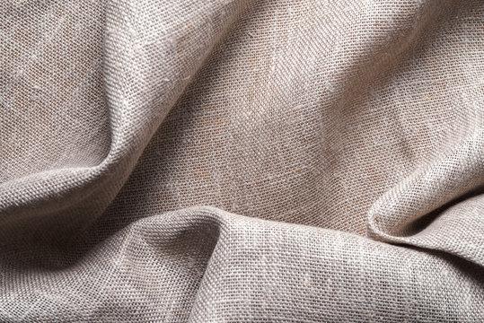 Background of linen napkin folded in folds