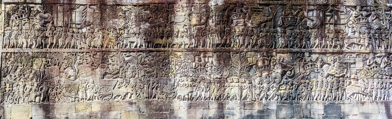 Panorama of bas relief at ancient Bayon temple in Angkor Thom, Siem Reap, Cambodia