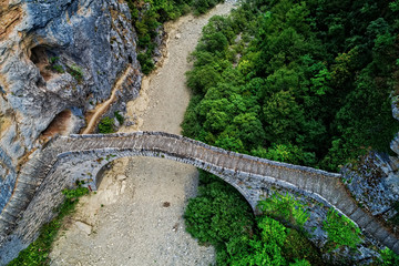 Old Kokkori - Noutsou arched stone bridge on Vikos canyon, Zagorochoria, Greece.