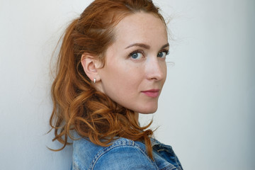 Close up view of beautiful Caucasian woman with ginger hair and freckles