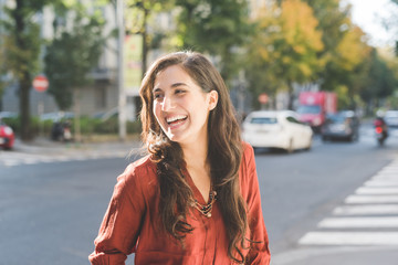 young woman posing outdoor laughing